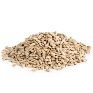 Shelled sunflower seeds over white background